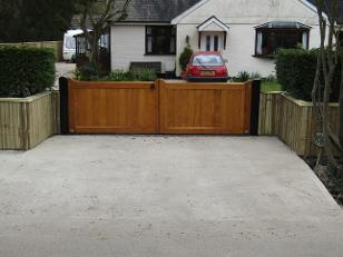 Flood Divert straight top gates in Accoya and treated with Sikkens Light Oak