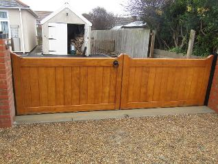 Straight Top Flood Divert Kitemarked gates made in Accoya and treated with Sikkens 'Light Oak' stain